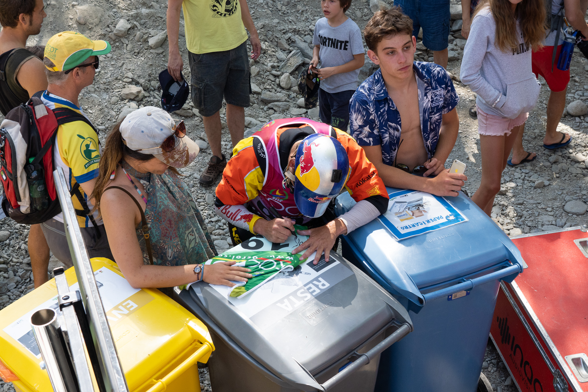 Just minutes before he takes the gold, Dane Jackson makes time to autograph a bib for a fan. ©Peter Holcombe: kayaksession.com