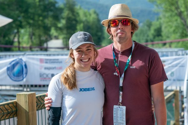 Two time world champion Ottilie Robinson-Shaw celebrates victory with coach Dennis Newton. ©Peter Holcombe:kayaksession.com