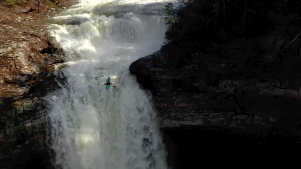 American whitewater paddler Jeremy Nash running a waterfall in the Pacific Northwest (PNW) of the US