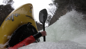 austrian kayaker, dan butler kayaks in winter in austria