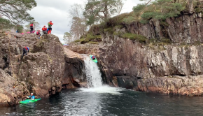 Uk Paddler Morgan Hayes runs a waterfalls on the Etive in Scotland
