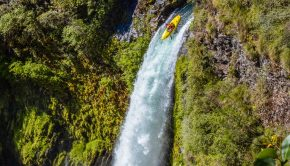 French RIder Tom Dolle running a waterfall in his kayak in chile