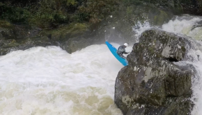 English Paddler James Hardint throwing a freewheel off a waterfall in Wales.