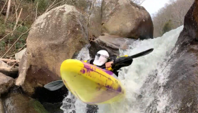 US Paddler Jack Orr Flying off a monster Boof in his kayak in the southeast of the usa. ©kayaksession.com
