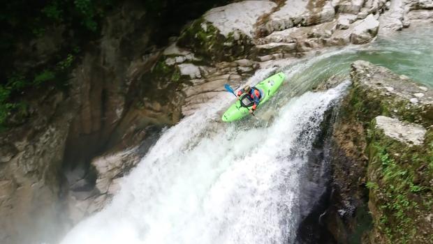 German kayaker Lucas Hummel running a drop in the austrian alps with his kayak.