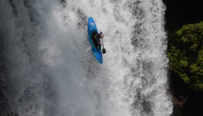 US kayaker Driscoll Larrow running a waterfall in his kayak in Chile.