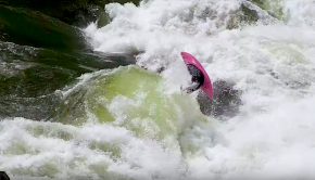 Dane Jackson throwing a back pistol flip on the pour over of the rapid #5 on the zambezi river in Zimbabwe.