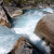 German kayaker Simon Hirt scouting a rapid on a river in Norway.