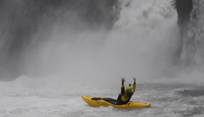 Italian Kayaker Matthias Weger celebrating a sick run off a waterfall with his kayak