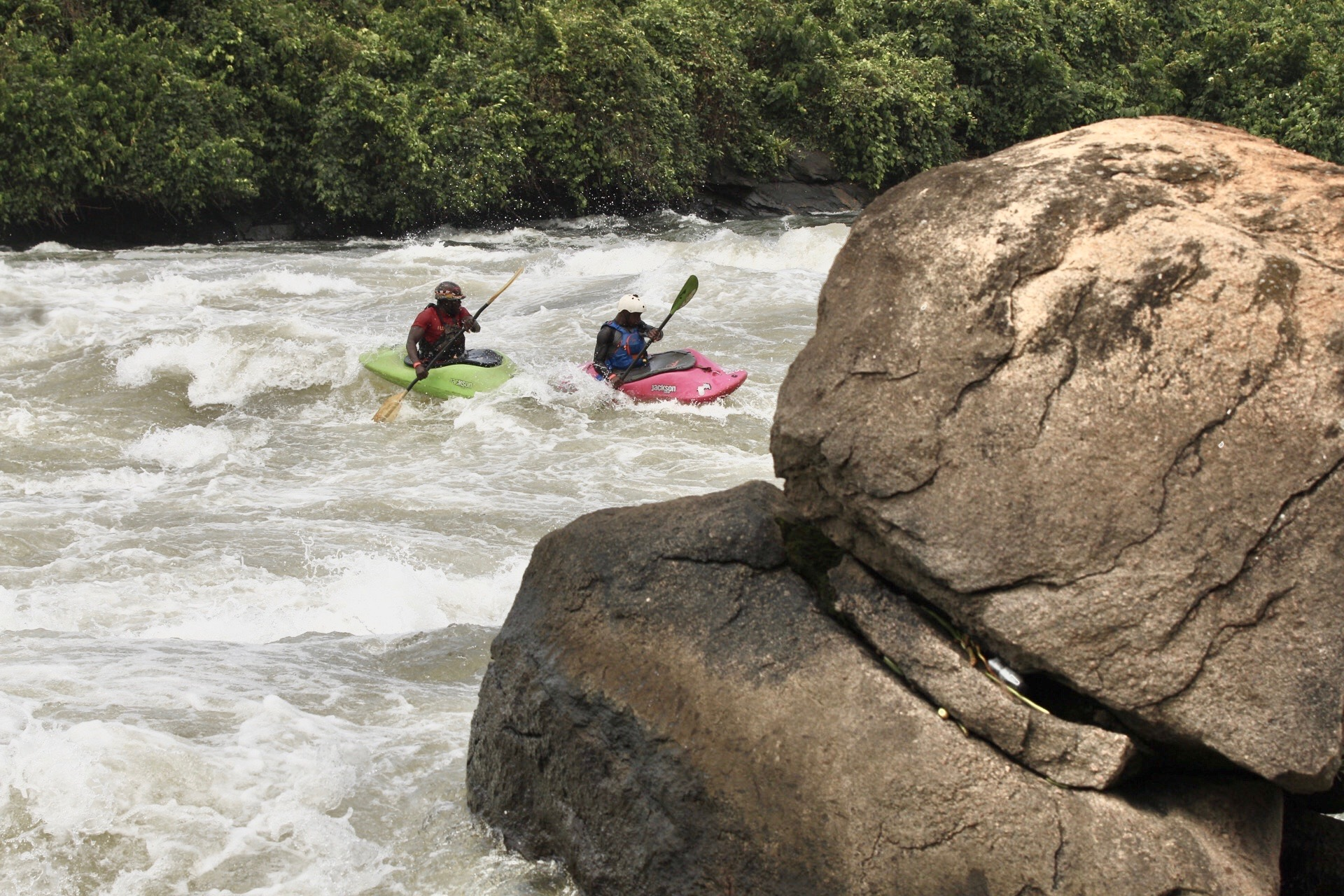 Paddlers racing down the Itanda section of the white NIle in Uganda during the 2020 Nile River Festival