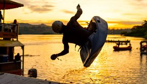 Paddler launching off the big air ramp at sunset during the Nile River Festival 2020
