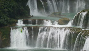 Dane jackson kayaking a waterfall in china