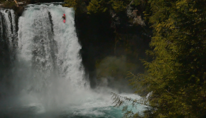 Jure Stan running a monster waterfall in his kayak in the Pacific NorthWest of the Usa