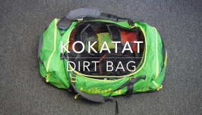 Kokatat Dirt Bag. There are grab handles on each end and compression straps. The included changing mat stores in a pocket on the bottom of the gear bag.