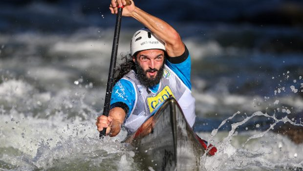 wildwater canoeiest from Italy Mattia Quintarelli racing at the 2019 Downriver racing World chamionships in La Seu D'urgell in Spain