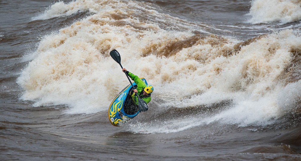 Freestyle Worlds medallist, Keeners program head coach Stephen Wright surfing a river wave in his kayak in Colombus Ga.
