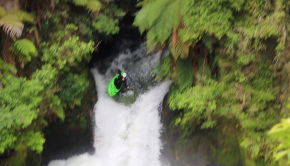kayaker runs a waterfall the kaituna river near rotorua, in new zealand