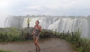 girls dancing in the rain facing victoria falls. zimbabwe is a whitewater paradise for kayakers