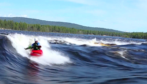 Tuisku Äänismaa surfs a wave in his kayak in Finland