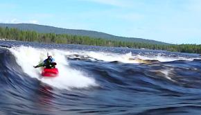 Tuisku Äänismaa surfs a wave in his kayak in Finland