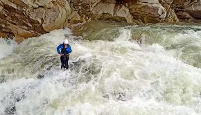 Ukranian paddler Ukraine Pavlo Mihiysky missing his roll and forced to swim on the Prut river (Ukraine), half way through Probiy waterfall, and ends up standing in the middle of the river